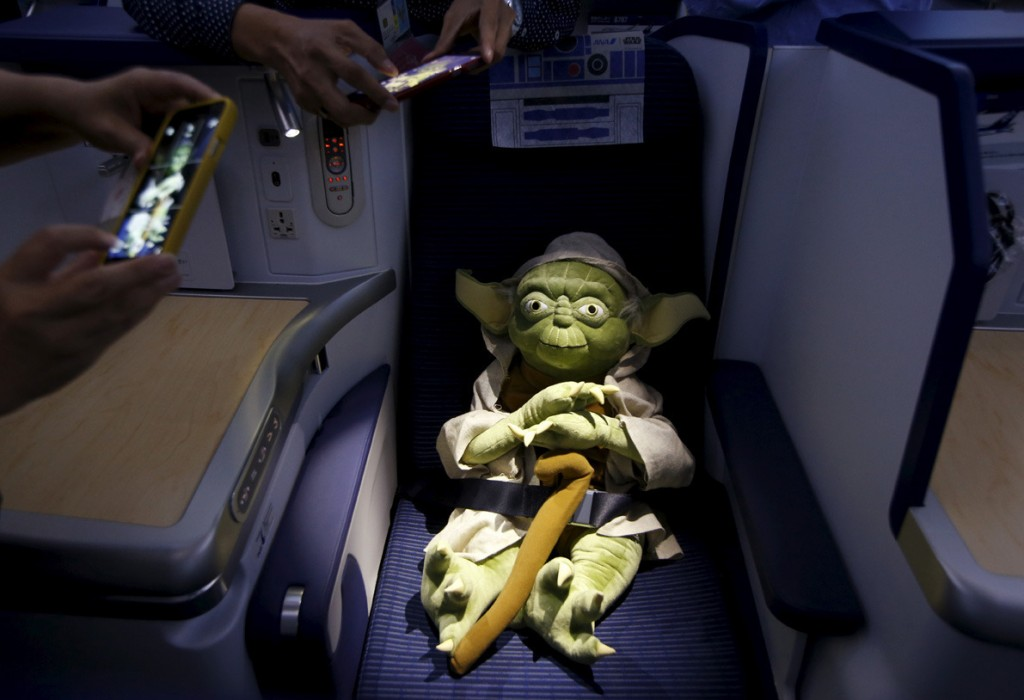 Image #: 40769506    Visitors take photos of a Yoda plush toy sitting in the business class section during a tour of the Star Wars themed All Nippon Airways ANA R2D2 Boeing 787 Dreamliner aircraft at Singapore's Changi Airport November 12, 2015. The aircraft was opened to the media on Thursday as it makes its first Asian stop outside Japan. REUTERS/Edgar Su  /LANDOV