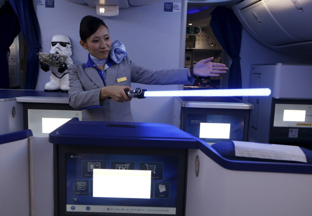 Image #: 40769587    A stewardess holding a lightsabre explains the features of the business class section during a tour of the Star Wars themed All Nippon Airways ANA R2D2 Boeing 787 Dreamliner aircraft at Singapore's Changi Airport November 12, 2015. The aircraft was opened to the media on Thursday as it makes its first Asian stop outside Japan. REUTERS/Edgar Su  /LANDOV