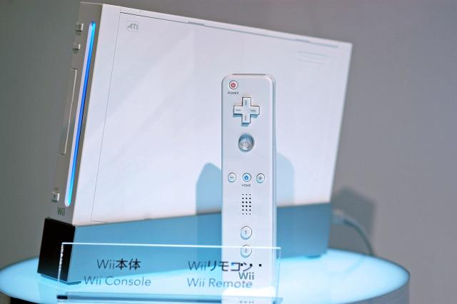 Nintendo unvelied its latest handheld game device, Wii, at a press event at Makuhari Messe near Tokyo, Japan on Thursday 14 September, 2006. Pictured here are the device's console and oe of its remote controls. Photographer: Robert Gilhooly/Bloomberg News
