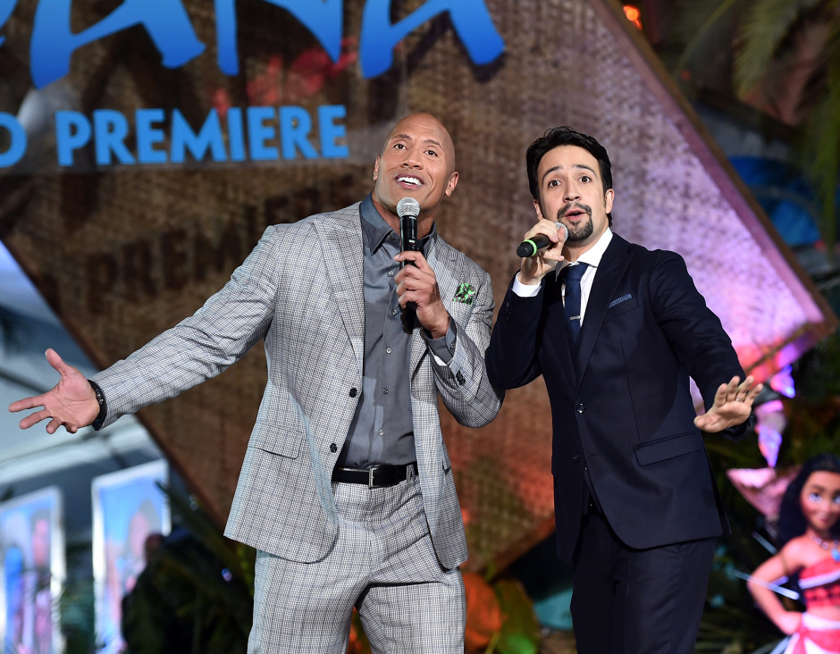 "HOLLYWOOD, CA - NOVEMBER 14: Actor Dwayne Johnson (L) and songwriter Lin-Manuel Miranda perform onstage at The World Premiere of Disney's ""MOANA"" at the El Capitan Theatre on Monday, November 14, 2016 in Hollywood, CA. (Photo by Alberto E. Rodriguez/Getty Images for Disney) *** Local Caption *** Lin-Manuel Miranda; Dwayne Johnson"