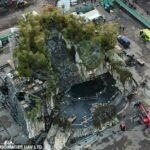 36042416-8981479-Dramatic_A_large_pit_had_been_built_into_the_makeshift_rock_face-a-117_1606218164033