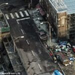 36042460-8981479-Dark_Abandoned_cars_and_piles_of_rubbish_were_strewn_across_the_-a-134_1606218713714